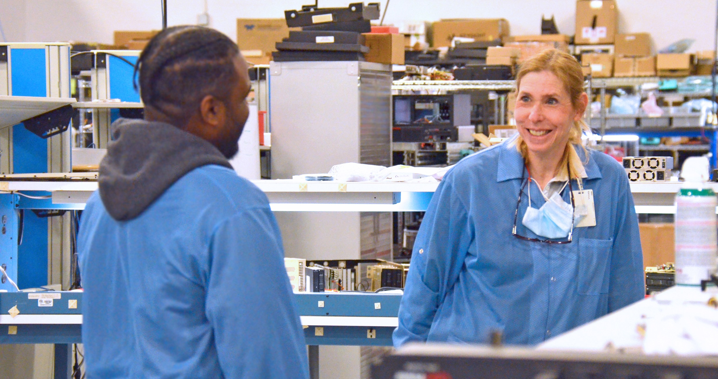 This is a photo of two Trenton Systems engineers conversing and laughing with each other.