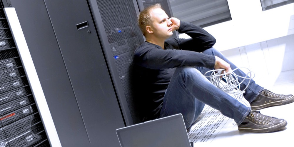 An IT specialist expresses frustration toward his technical issue
