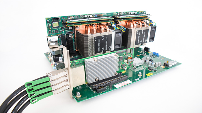 This is a photo of a PCIe expansion kit plugged into a PCIe slot on a backplane and dual-CPU processor board combo.