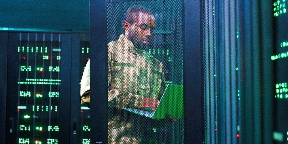 A man inspects a military server