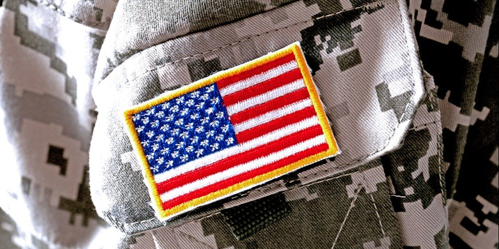 This is a closeup of an American flag stitched onto a U.S. Army uniform