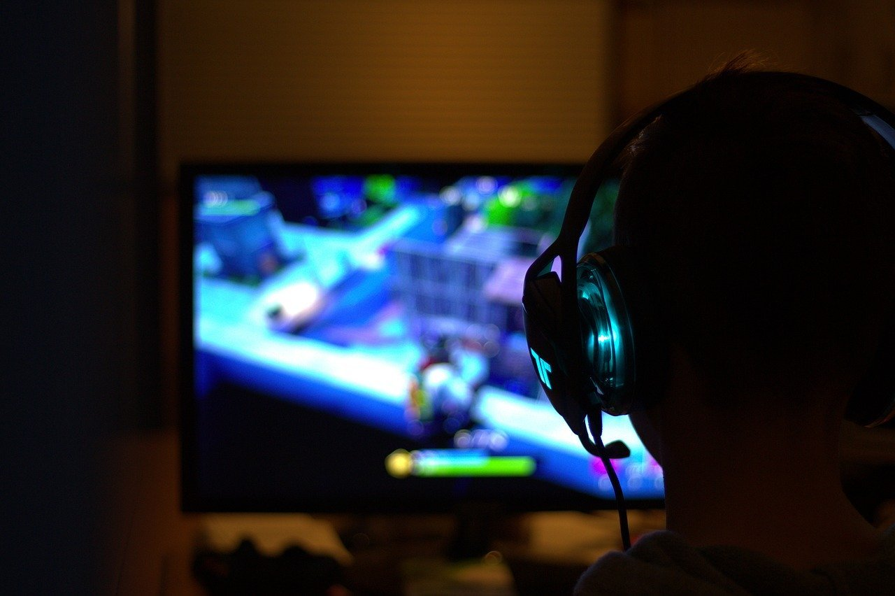 A PC Gamer playing a video game