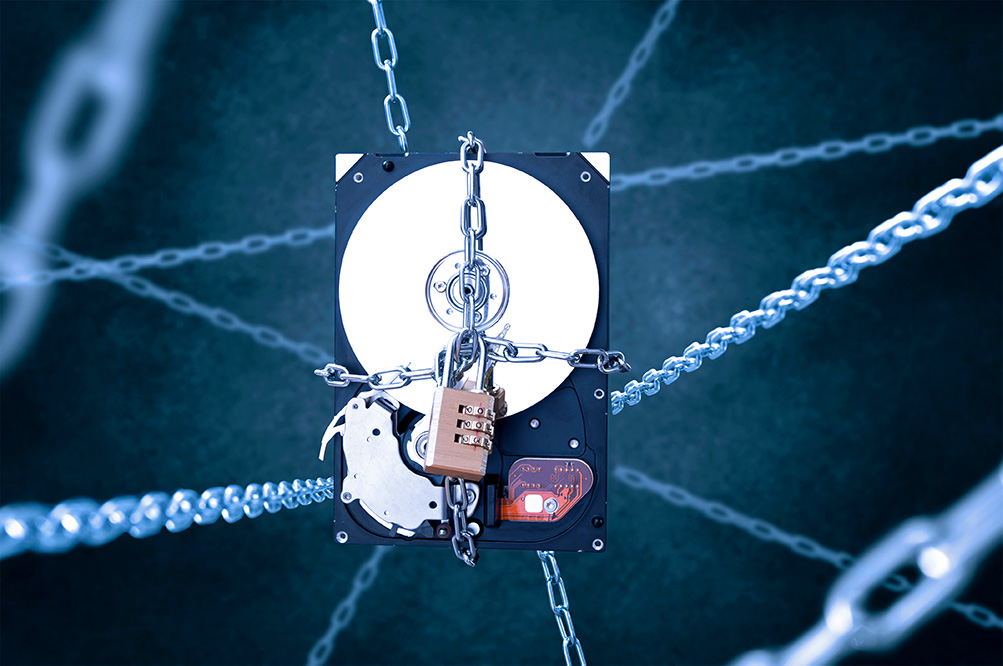 A hard drive with a lock and chain around it