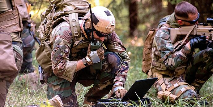 A soldier in the field communicates with command