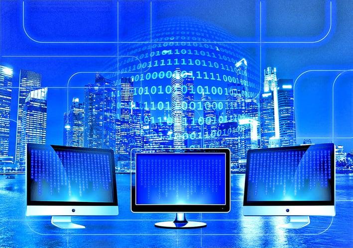 computer monitors showcasing binary code