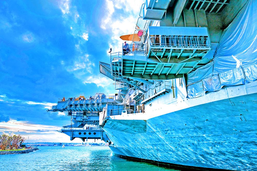A photo of a U.S. Navy ship on the water in San Diego, California.