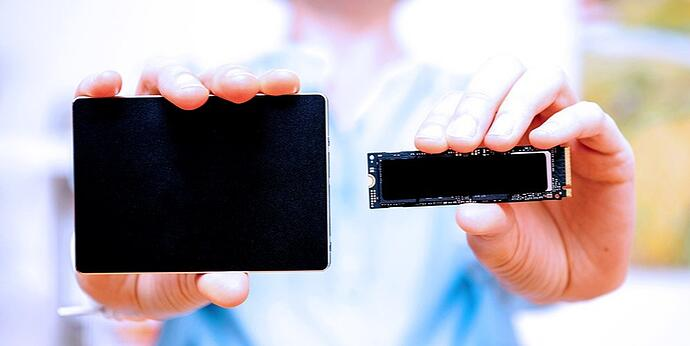 A closeup of the two common NVMe SSD form factors: U.2 (left) and M.2