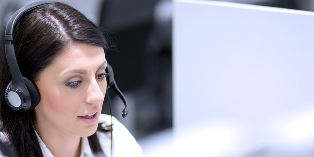 A technical support agent works on solving a customer's problem