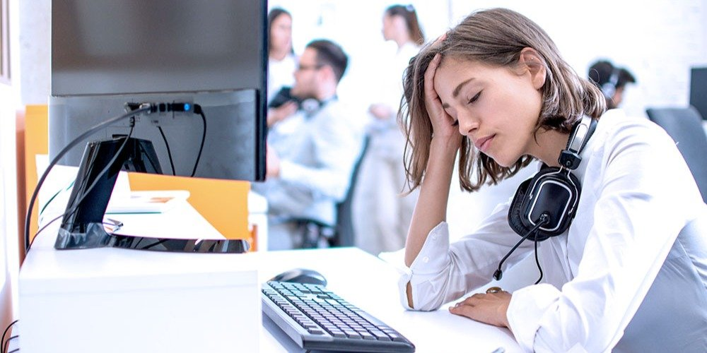 A technical support agent looks exhausted