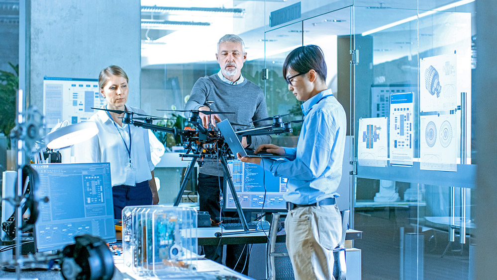 aviation engineers work on a drone in a science lab